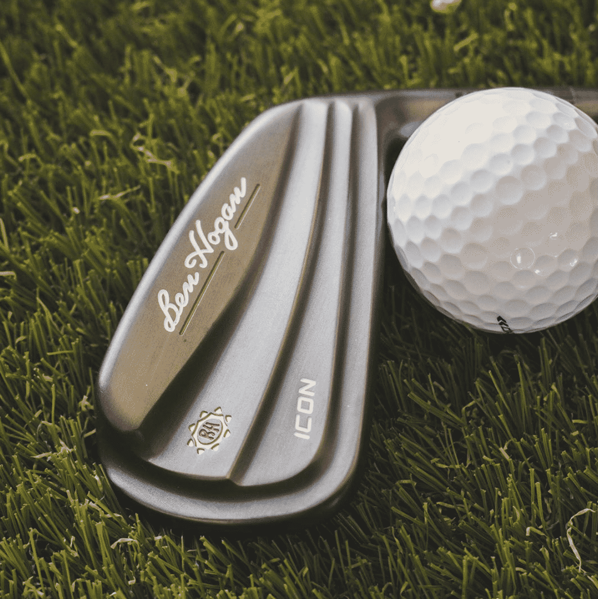 Icon iron and ball on the fairway